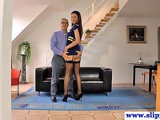 Tall posing stewardess licks an old mans cum