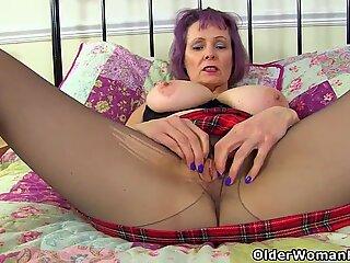 English grannie Tigger raises up her tartan mini-skirt for pleasure