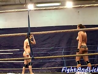 Bigtit lesbians wrestling in a boxing ring