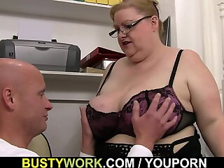 Heavy lady boss with glasses rides his dick