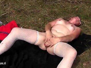 Squirting mature slut mom masturbating in the woods