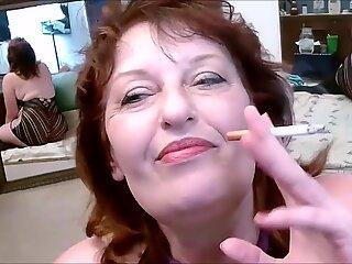 Hot grandma smoking teasing and talking dirty in cam