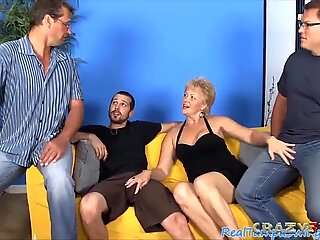 light-haired grandma deep-throating three hard dicks